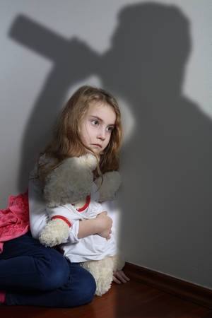 pedophilia: Shadow drunk parent over the frightened girl