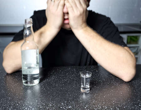 alcohol abuse: alcohol abuse - drunk man with vodka