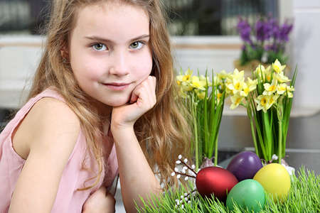 Lovely young girl getting ready for Easter photo