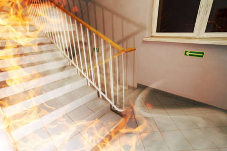 burning house: The staircase burns in the building Stock Photo