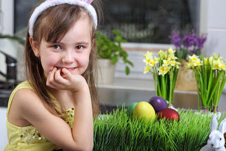 funny easter: Preparing for Easter - young smiling girl