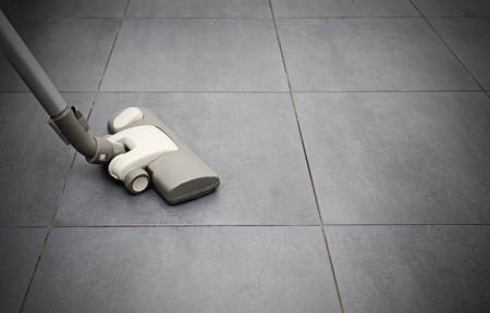 saprophyte: vacuuming flooring in kitcen
