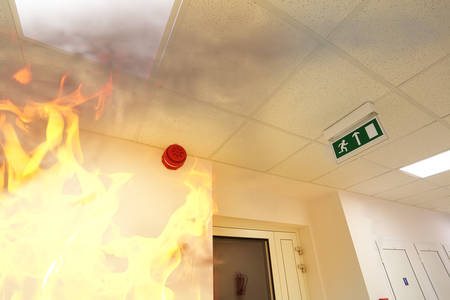 fire exit sign: Fire alarm! Stock Photo