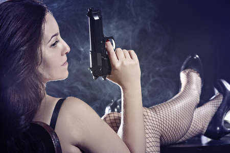 Pretty girl with a gun Stock Photo