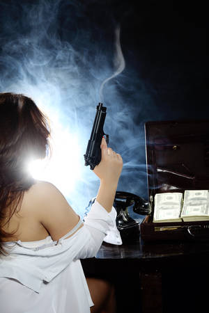 gangster girl: Feminine and sensual Bad girl with gun Stock Photo