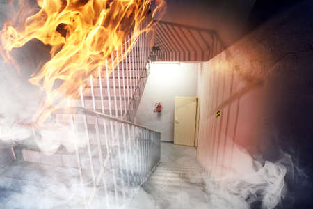extinguisher: Fire in the building - emergency exit Stock Photo