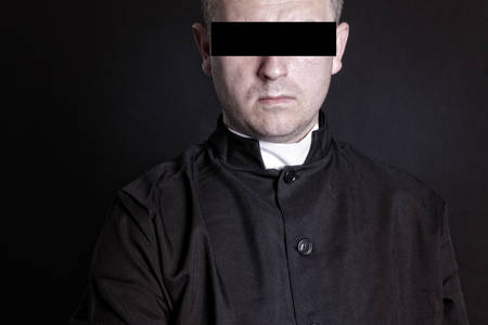 pedophilia: Priest suspect blindfolded Stock Photo