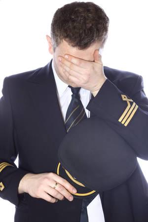 piloto: Piloto triste y avergonzado Foto de archivo
