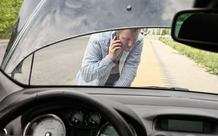 calling for help: Broken car and the man calling for help