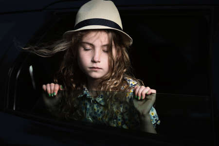 hankering: Pensive and laid-back girl in a car Stock Photo