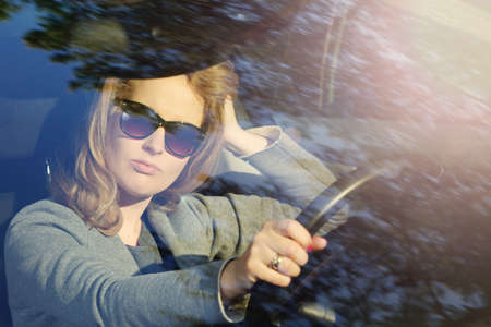 enterprising: Pensive young businesswoman in a car stuck in traffic Stock Photo
