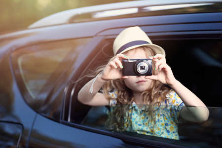 vehicle window: Holiday adventure - the girl in the car with the camera