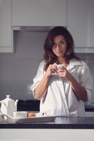 sensual girl: charming girl in the kitchen during a morning coffee