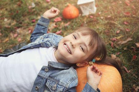 girl lying: laughing girl lying in autumn leaves