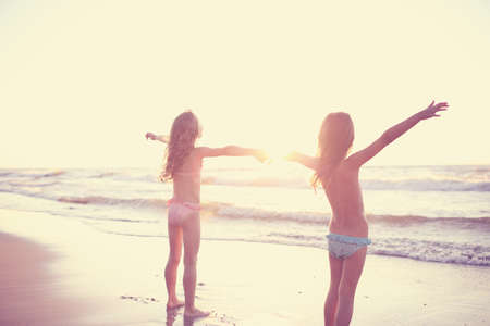 Two young friends enjoy the sunny day at the beach Stock Photo