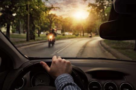 町の周りに車を運転 写真素材