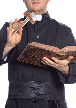exorcist: priest with bible and cross Stock Photo