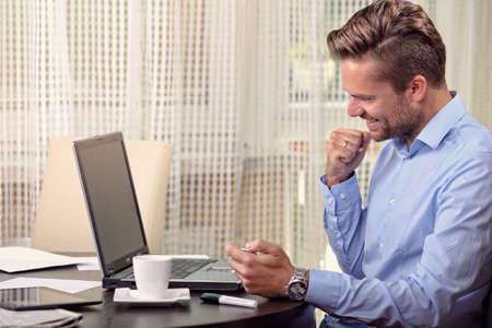 let out: businessman in a mans shirt with success Stock Photo