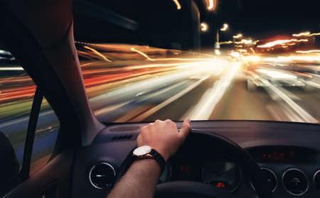 Paseo muy rápido en un coche por la noche Foto de archivo - 46180195