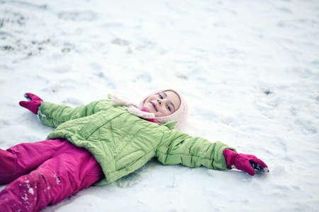 youthful: Youthful girl playng outside in snow Stock Photo