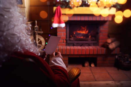 carols: Santa Claus with a letter from a child