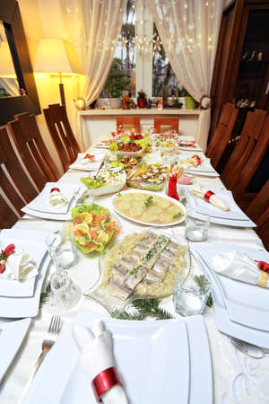 christmas table: lavishly set table on Christmas Eve