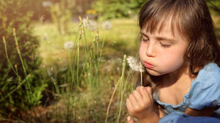 lonliness: Girl with dandelions in the meadow