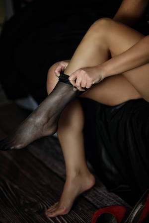 Sexy and mysterious woman assumes stockings