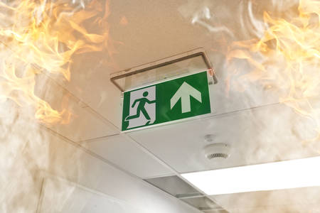 building on fire: Emergency exit - fire in the office