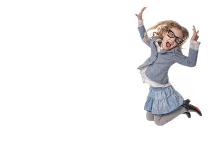 antics: Young girl jumps on a white background