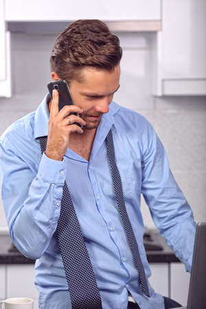 enterprising: young man talking on the phone Stock Photo
