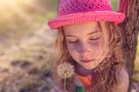 lonliness: Young girl with dandelions