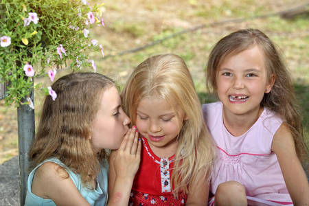 little  girls: Friends playing in the garden on a sunny day