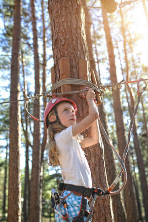 Young girl on the rope park Stock Photo