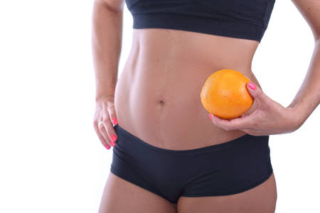 free radicals: Girl with a flat belly holding orange