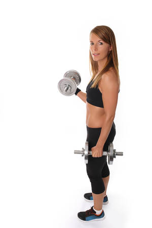 Young slim girl with dumbbells on a white background