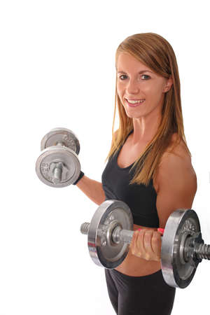 stretching condition: Lovely fitness trainer with dumbbells