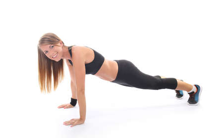 stretching condition: Athletic young woman practicing plank
