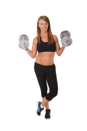 Young slim girl exercising with dumbbells on a white background