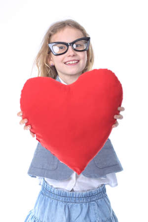 delightfully: Delightfully smiling young girl with a heart Stock Photo