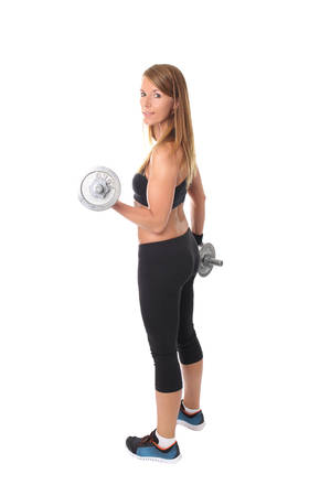 stretching condition: Young slim girl exercising with dumbbells on a white background