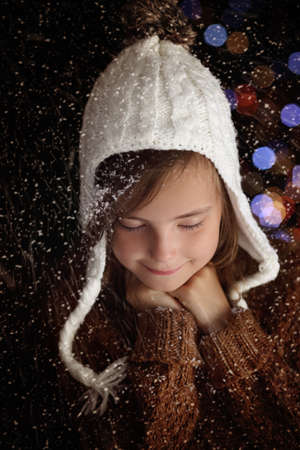 dream land: Pensive young girl in winter christmas evening