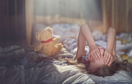 violent: Lonely little child crying in the room Stock Photo