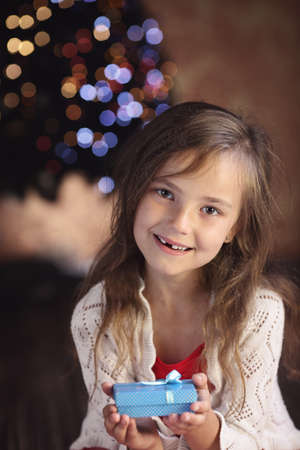 suprise: Young girl with a Christmas present