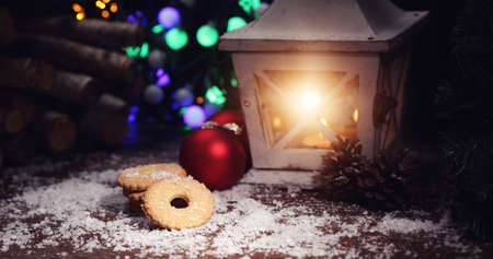 stupendous: Moody winter evening with a lantern and baubles Stock Photo