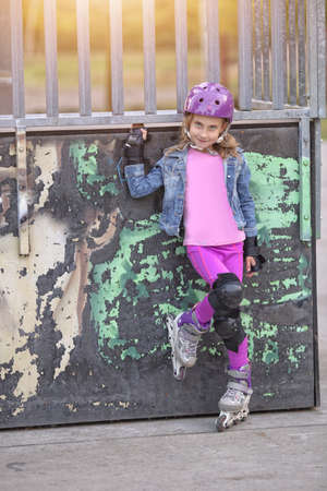 professionally: young and fashionably dressed girl roller