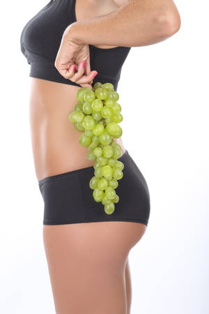 stretching condition: Fruit diet - girl holding grapes