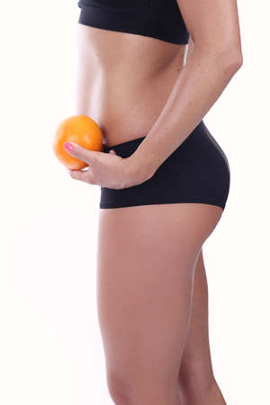 stretching condition: Fruit diet - girl holding an orange