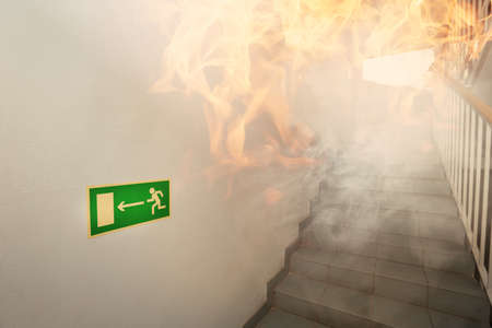 evacuate: Fire in the building - emergency exit Stock Photo