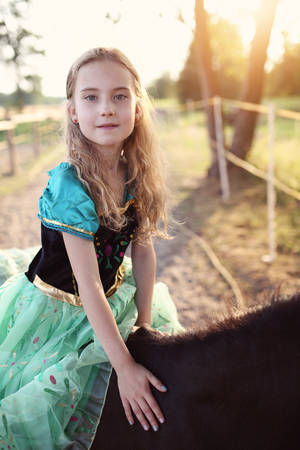 young girl sitting on a horse
